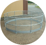 Circular, galvanised handrails for a silo top.