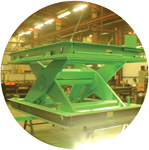 A heavy duty sissor-lift table capable of lifting over 10 tonnes.