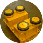 A large fabricated bracket with hardened wheels for a large overhead crane.